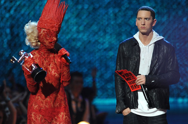 Eminem gives Lady Gaga the old sideways glance as the cloaked pop star