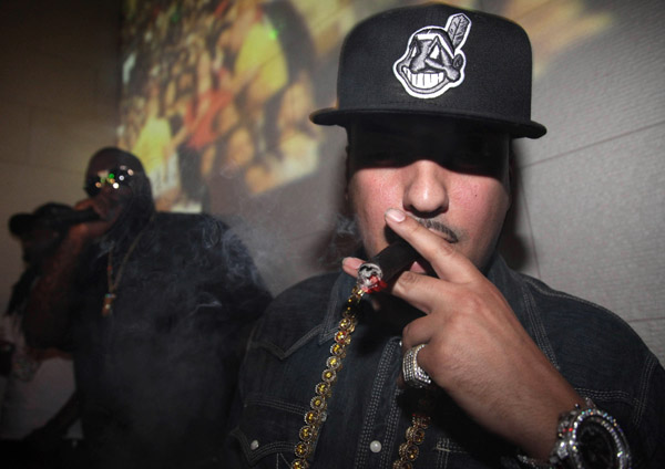 French Montana smoking a cigarette (or weed)
