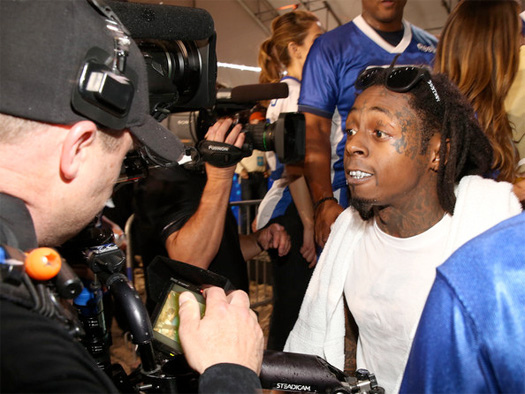 Lil Wayne Gets Into Fight With Cameraman At Celebrity ...Gangster Elmo Vs Lil Wayne