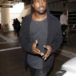 Kanye West calmly man-handles a paparazzi